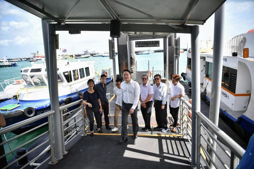 Senior Minister of State for Transport and Health Lam Pin Min (front) visiting Marina South Pier on Feb 20, 2020.