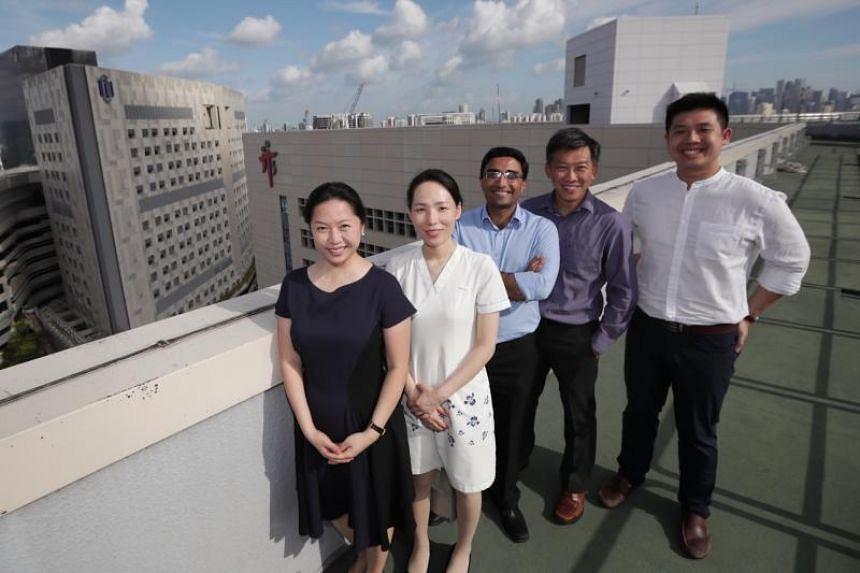 (From left) Dr Melissa Tien, senior staff nurse Xie Linlin, Dr Sunder Balasubramaniam, Dr Nelson Chua and Dr Thomas Aloysius Wong at Tan Tock Seng Hospital on Feb 20, 2020.