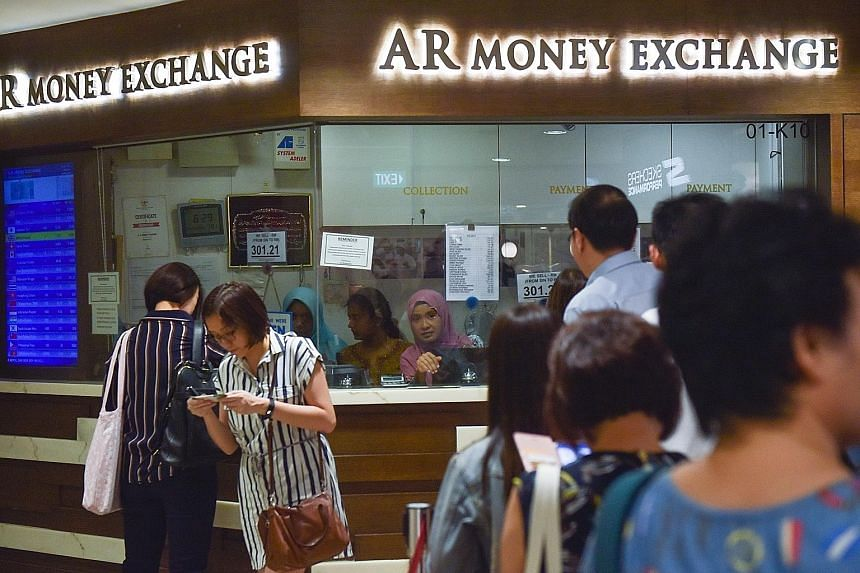 Asian currencies dropped under the weight of the virus outbreak yesterday, with South Korea's won sinking more than 1 per cent to 1,201.95 to the US dollar, and the Thai baht falling 0.7 per cent to 31.406 to the dollar.