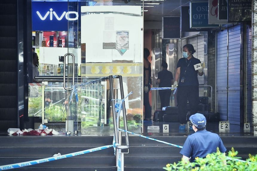 A photo taken on July 2, 2019, shows Orchard Towers' main entrance cordoned off for police investigations. A man was found earlier on the ground at the entrance in a pool of blood.