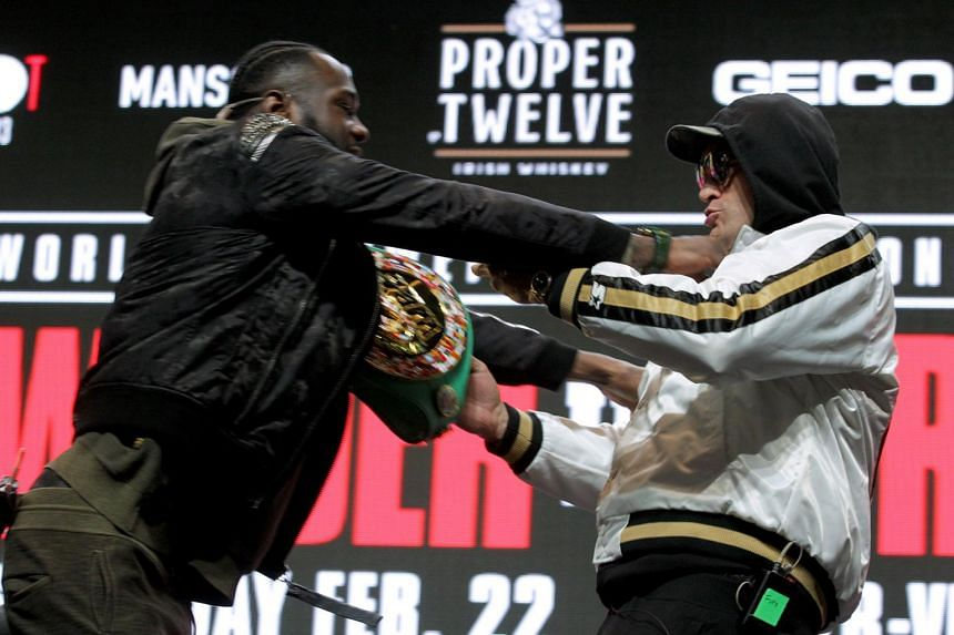 Heavyweights Deontay Wilder (left) and Tyson Fury shove each other on stage during a news conference at the MGM Grand in Las Vegas on Feb 19, 2020.