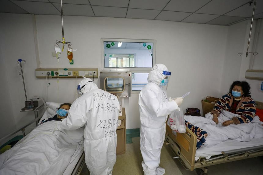 Medical personnel work in the patients' ward at Jinyintan Hospital, designated for critical coronavirus patients, in Wuhan on Feb 13, 2020.