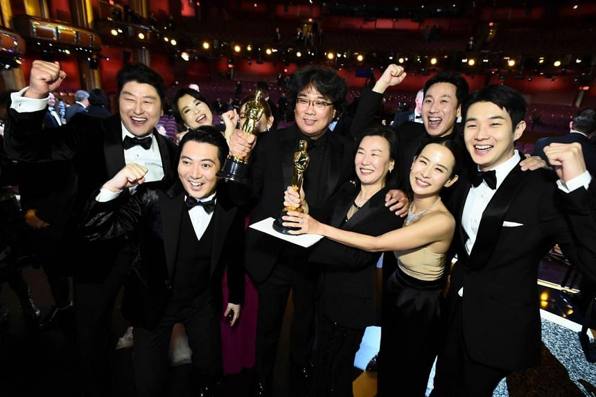 Parasite director Bong Joon Ho (centre) and cast of film at the 92nd Academy Awards, on Feb 9, 2020.