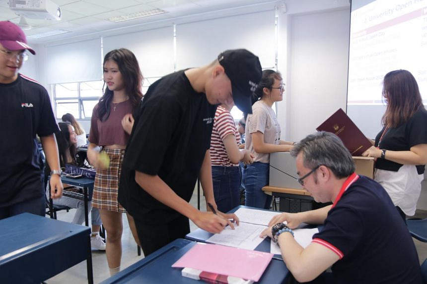 Students receiving their A-level results at Jurong Pioneer Junior College on Feb 21, 2020.