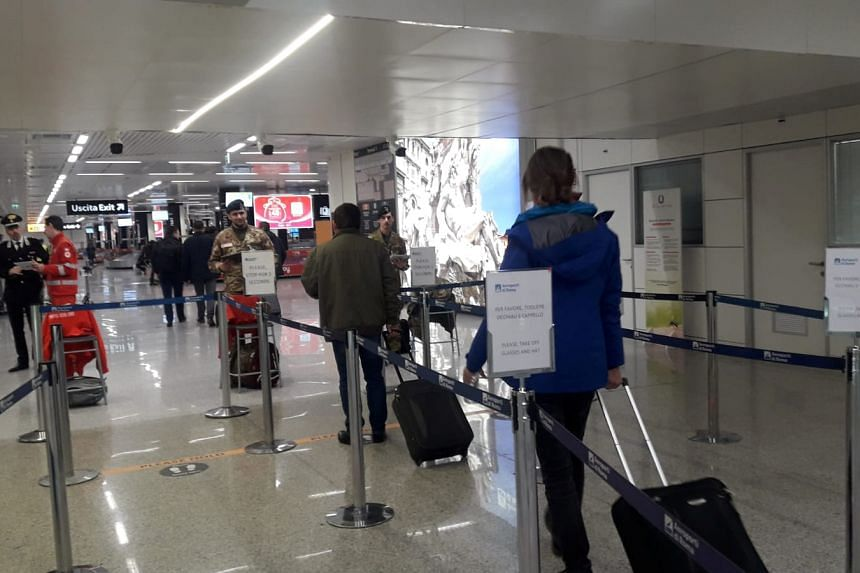 A photo taken on Feb 4, 2020, shows travellers arriving at Rome's Fiumicino airport. Italy has four confirmed cases of the coronavirus so far.