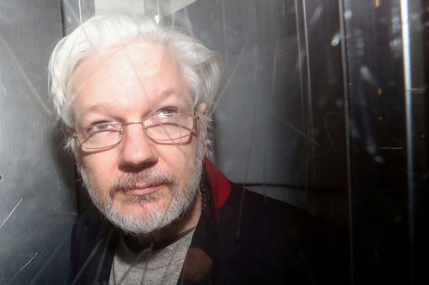 WikiLeaks' founder Julian Assange leaves Westminster Magistrates Court in London, Britain, on Jan 13, 2020.