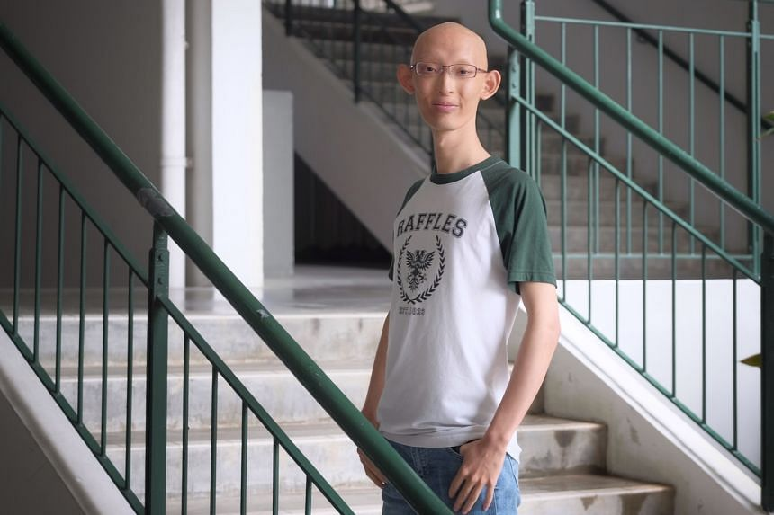 Loh Yih Hang has no sweat glands and minimal salivary glands, but has come to accept that his medical condition is part of who he is. He hopes to pursue computer science in university.