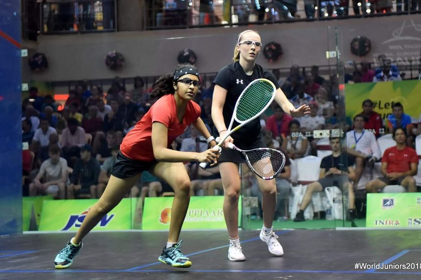 A photo taken on July 21, 2018, shows Singapore's Sneha Sivakumar's (left) in action during the World Junior Squash Championships quarter-final match against England's third-seed Lucy Turmel in Chennai.