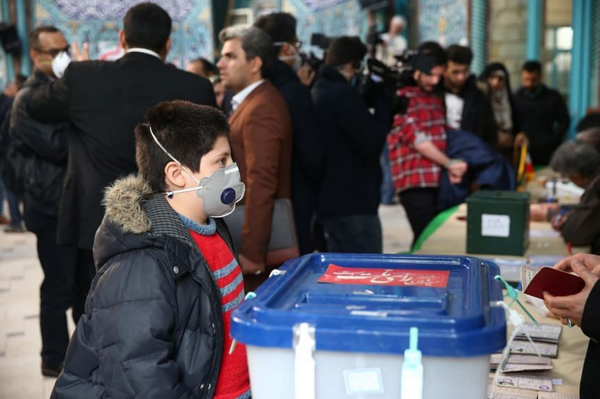 The widening outbreak came as Iranians were voting in a parliamentary election seen as a referendum on authorities after a series of crises.