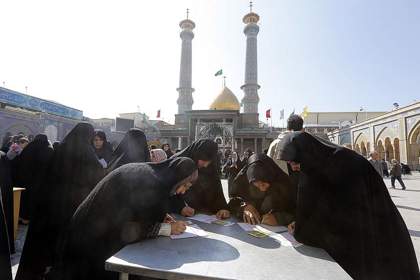 Iranian women at a polling station set up at the Shah Abdul Azim shrine during the parliamentary elections in Teheran yesterday.