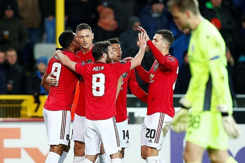 Manchester United are in the driver's seat of their Europa League last-32 tie after Anthony Martial (far left) equalised in the 1-1 draw with Club Brugge on Thursday. The second leg will be played at Old Trafford next week.