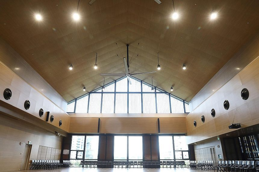A cavernous multi-purpose hall is among the spaces available to the public in the building.