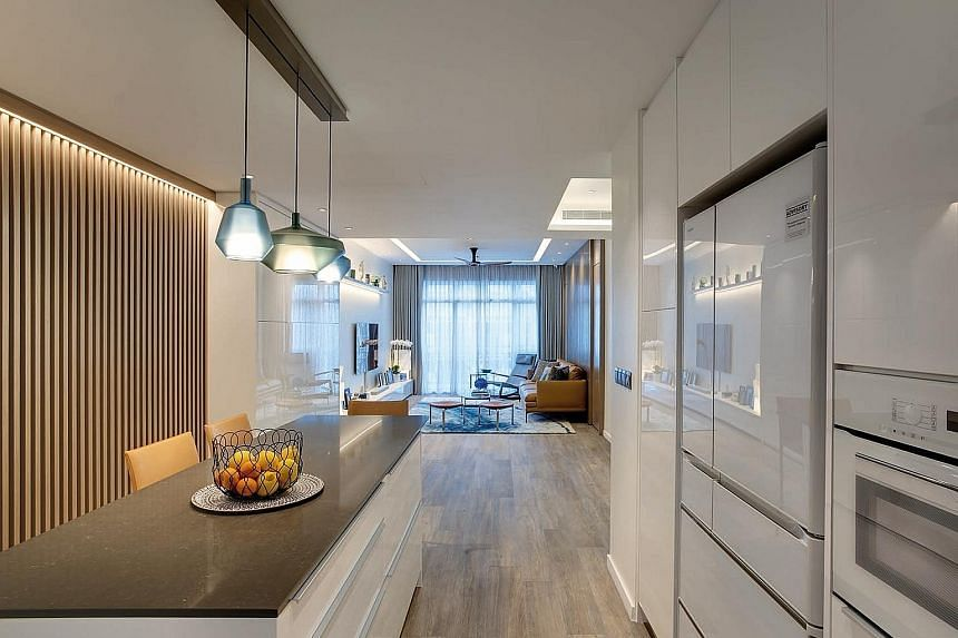 The open kitchen allows the home owners to interact easily with guests in the living room.