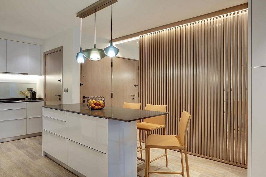 A subtle pop of colour and light come from three pendant lamps above the island counter.