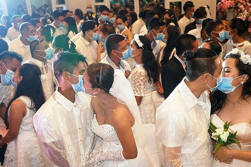 Wearing blue surgical masks amid the coronavirus outbreak, 220 couples exchanged vows and kisses on Thursday in the central Philippines to begin their married lives in the coastal city of Bacolod. Participants had to complete health declarations deta