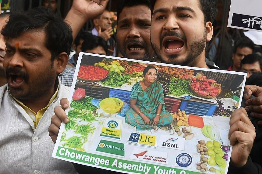 Activists of the Indian National Congress party protesting against the Bharatiya Janata Party-led central government for proposing a partial listing of Life Insurance Corporation through an initial public offering, in front of an LIC office in Kolkat