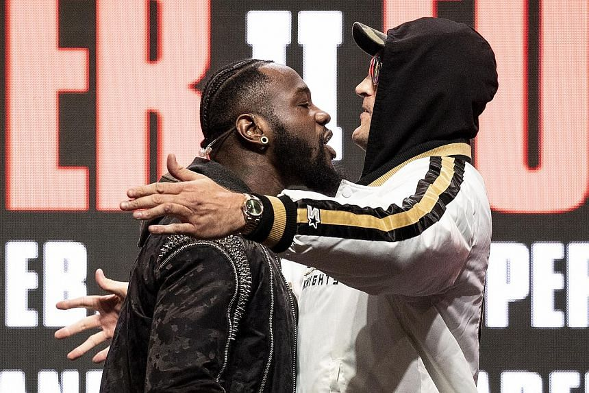 American Deontay Wilder and Briton Tyson Fury facing off on stage during their last press conference on Wednesday ahead of today's rematch for the WBC heavyweight world championship in Las Vegas, Nevada. After exchanging shoves, they hurled insults a