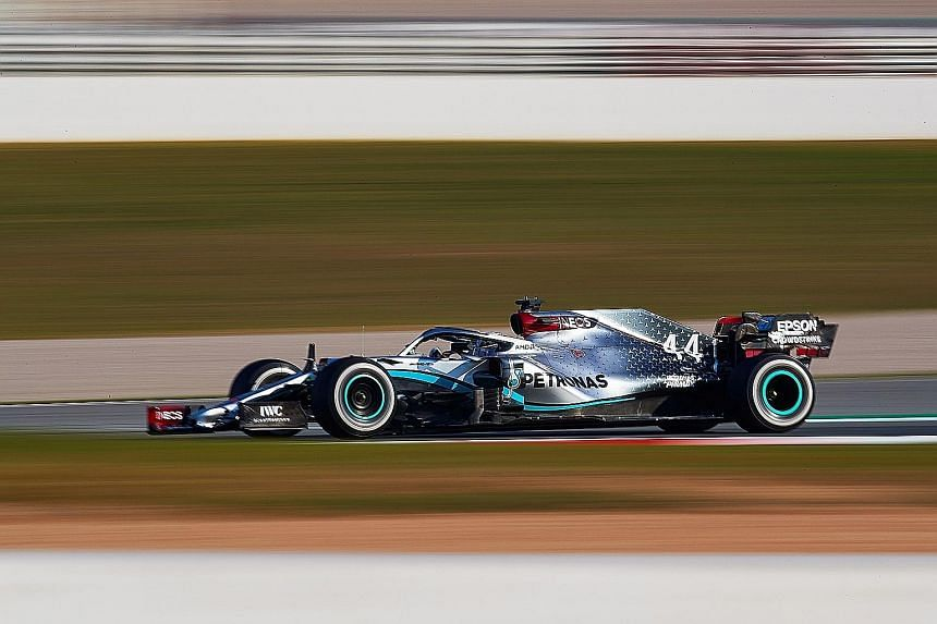 Above: Mercedes' Lewis Hamilton during the official Formula One pre-season testing at the Barcelona-Catalunya circuit on Thursday. Left: Hamilton's steering wheel.