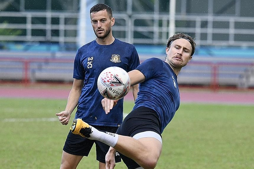 Above: Hougang's new men Charlie Machell (left, forward) and Zachary Anderson (centre-back) in training. Left: Stipe Plazibat, who has 49 goals in 67 games in Singapore's professional league, will be deployed up front after featuring in a wide positi
