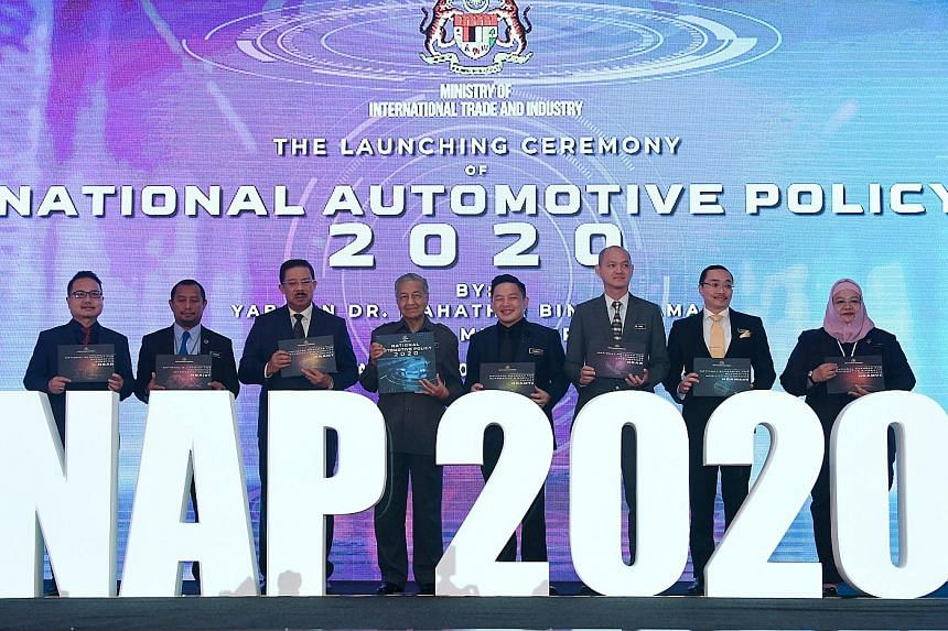 Malaysian Prime Minister Mahathir Mohamad at the launch of the National Automotive Policy 2020 yesterday. Among those present were International Trade and Industry Minister Darell Leiking (fourth from right) and Deputy Minister Ong Kian Ming (third f