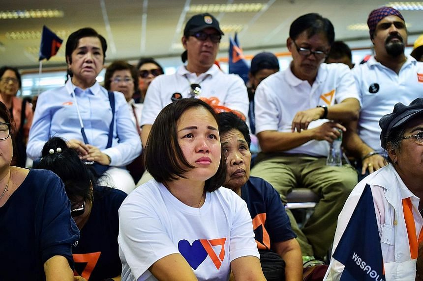 Future Forward leader Thanathorn Juangroongruangkit is among those slapped with the 10-year ban. Future Forward Party supporters in despair after Thailand's Constitutional Court disbanded the party yesterday. The opposition party is now left with 64