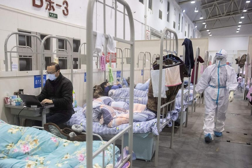This photo taken on Feb 17, 2020, shows patients and staff at an exhibition centre converted into a hospital in Wuhan in China's central Hubei province.