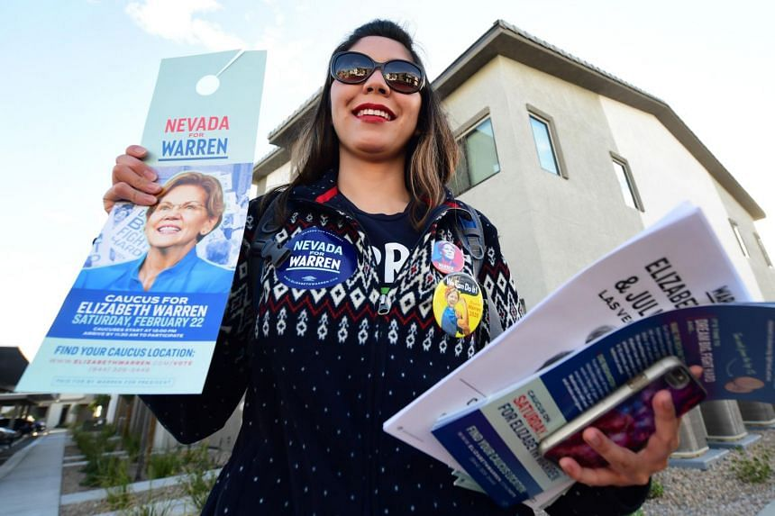 Elizabeth Warren supporter Ninna Diaz poses with material while out knocking on doors of registered Democrats and Independents to make sure people are registered to vote in Las Vegas on Feb 21, 2020.