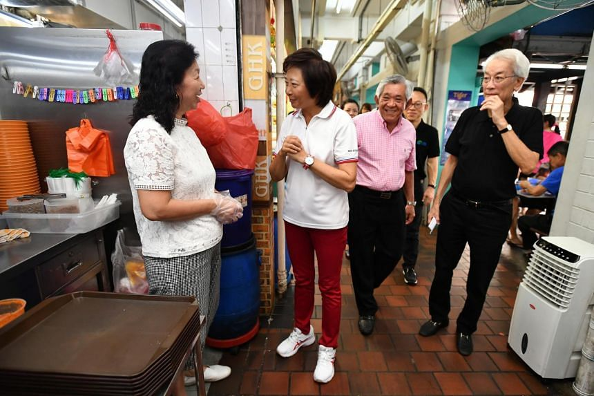 (From left) Co-owner of 848 Ban Mian Teo Siew Tin speaks to Nee Soon South MP Lee Bee Wah, alongside GHK Holdings chairman Goh Hung Kwang and Public Hygiene Council chairman Edward D'Silva at the GHK coffee shop at Yishun Street 81 on Feb 22, 2020.