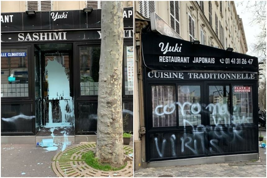 """The exterior and windows of Japanese restaurant """"Yuki"""" was defaced with """"coronavirus"""" and """"virus"""" graffiti, along with a big splash of light-blue paint on the door."""