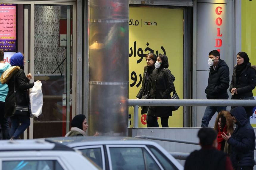 People walking on a street in Teheran on Feb 20, 2020. Iran has reported a total of five deaths and 28 infections from the coronavirus.