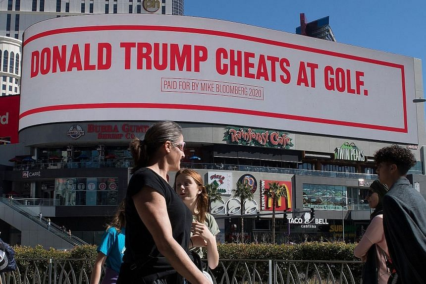One of the slogans on the giant digital billboard paid for by Democratic presidential hopeful Michael Bloomberg and displayed near the hotel where US President Donald Trump is staying while in Las Vegas. PHOTO: AGENCE FRANCE-PRESSE