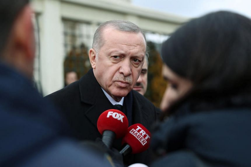 Turkish President Recep Tayyip Erdogan talks to journalists in front of a mosque as he leaves Friday prayers in Istanbul, Turkey, on Feb 21, 2020.