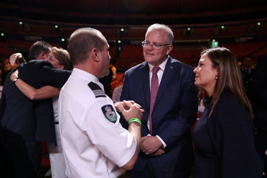 Australian Prime Minister Scott Morrison greeting attendees following a state memorial honouring victims of the bushfires at Qudos Bank Arena in Sydney, on Feb 23, 2020.