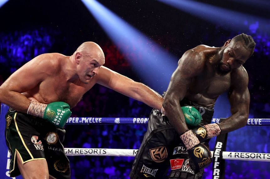 Tyson Fury (left) punches Deontay Wilder during a match in MGM Grand Garden Arena in Las Vegas on Feb 22, 2020.
