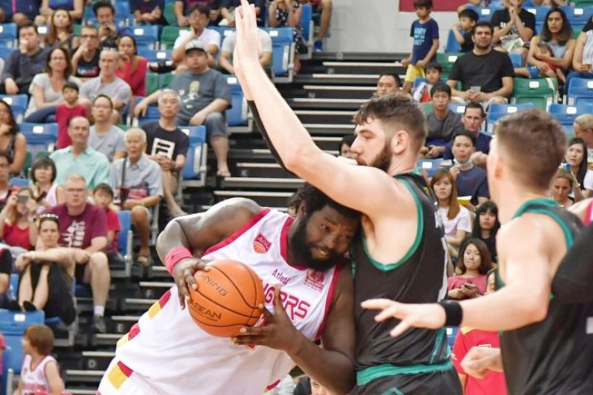 Singapore Slingers Anthony Daquise McClain (left) in action against the Kuala Lumpur Dragons at OCBC Arena Hall 1 on Feb 23, 2020.