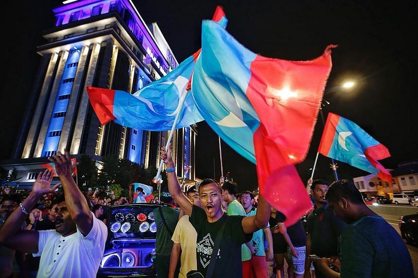 Pakatan Harapan supporters in Johor Baru celebrating PH's victory in Malaysia's general election in May 2018. Malaysia could yet again go to the polls to choose between Dr Mahathir Mohamad and Mr Anwar Ibrahim in 2023.