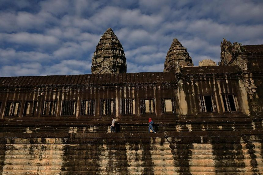 In a photo taken on Dec 6, 2019, tourists visit the Angkor Wat temple in Siem Reap.