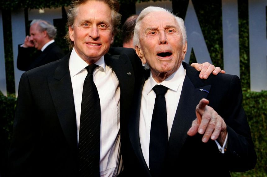 Actor Michael Douglas (left) and his father, actor Kirk Douglas, arrive together at the 2009 Vanity Fair Oscar Party in West Hollywood, California, on Feb 22, 2009.
