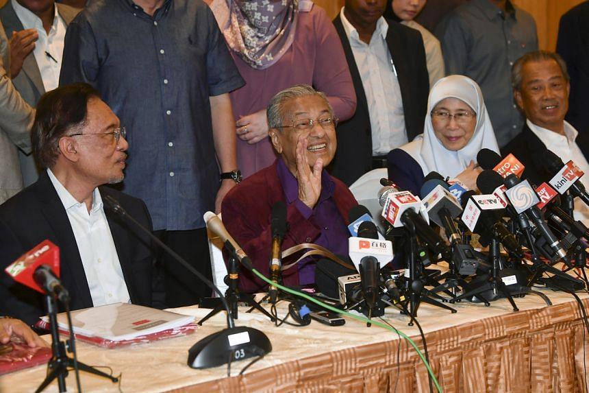 A photo taken on Feb 21, 2020, shows (from left) Parti Keadilan Rakyat president Anwar Ibrahim, Malaysia's Prime Minister Mahathir Mohamad, Malaysia's Deputy Prime Minister Wan Azizah Wan Ismail and Parti Pribumi Bersatu Malaysia president Muhyiddin