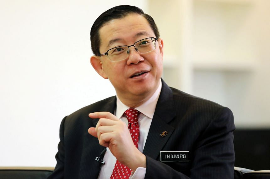 """Malaysia's Finance Minister Lim Guan Eng said the manoeuvre to form a unity government with opposition parties was a """"treachery of some PH leaders""""."""