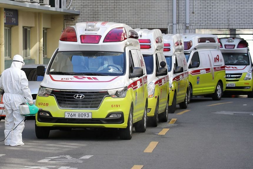 Ambulances carrying patients infected with the coronavirus arrive at a hospital in Daegu, Korea, on Feb 23, 2020.