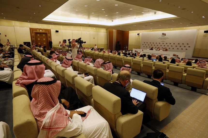 Saudi Finance Minister Mohammed Al-Jadaan (centre) speaks during a news conference at the end of the meetings of finance ministers and central bank governors of the G-20, in Riyadh on Feb 23, 2020.