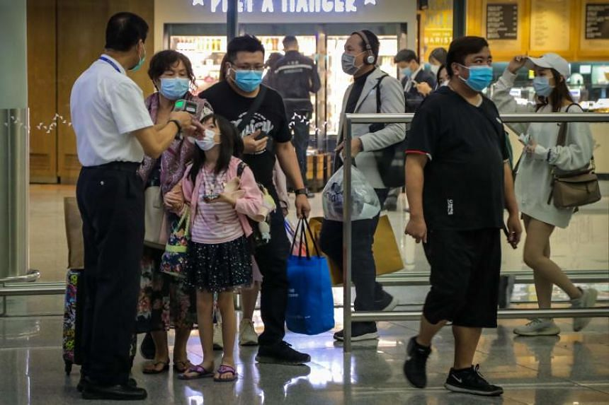 HK to give big cash handouts as economy reels from virus