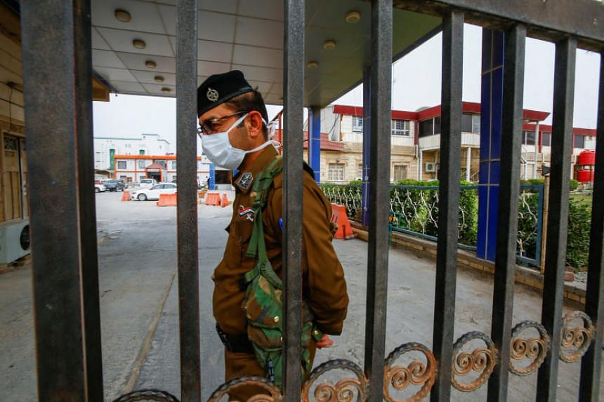 An Iraqi security officer wears a protective mask at a hospital in the holy city of Najaf, Iraq, on Feb 24, 2020.