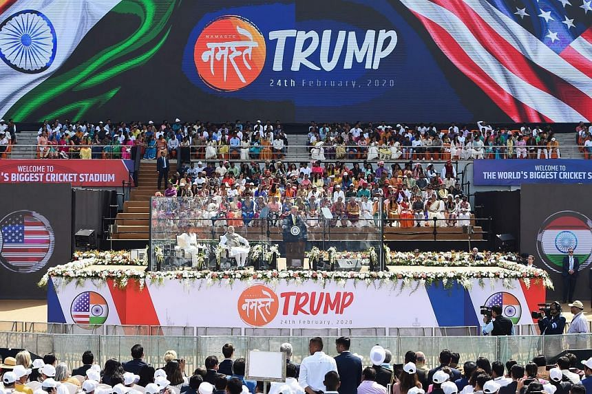 "United States President Donald Trump speaking at the ""Namaste Trump"" rally, with India Prime Minister Narendra Modi and First Lady Melania Trump with him on stage, at Sardar Patel Stadium in Motera, Ahmedabad, yesterday. PHOTO: AGENCE FRANCE-PRESSE"
