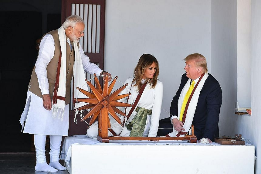 US President Donald Trump and First Lady Melania Trump sitting next to a charkha, or spinning wheel, during their visit to Gandhi Ashram in Ahmedabad yesterday with India's Prime Minister Narendra Modi. The spinning wheel is associated with Mahatma G