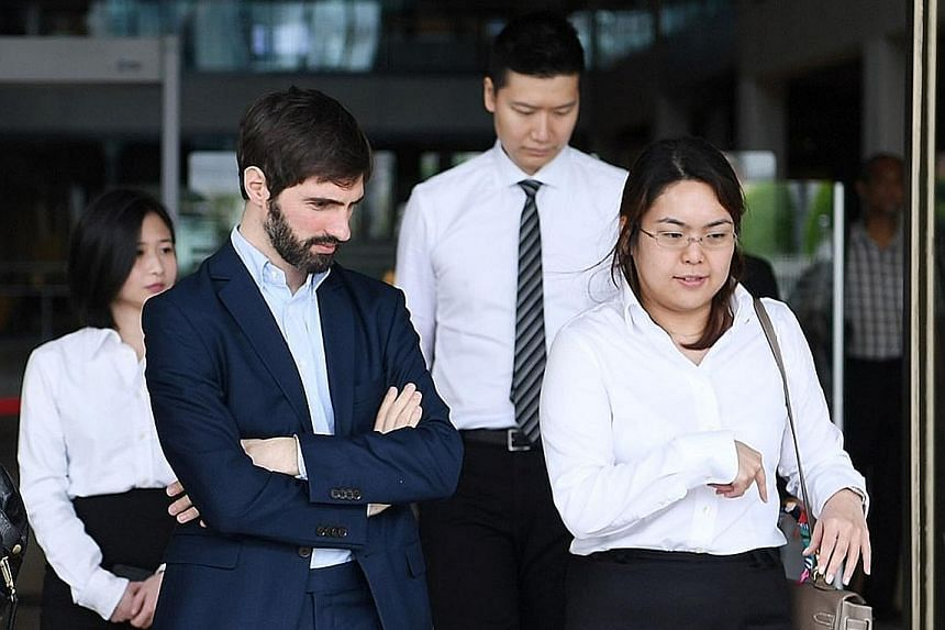 B2C2 co-founder Maxime Boonen (in blue) with his lawyers at the Supreme Court on Nov 21, 2018, for the trial of Singapore's first legal dispute involving cryptocurrency. The Court of Appeal ruled yesterday that virtual currency exchange operator Quoi