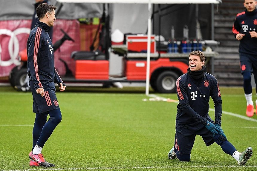 Robert Lewandowski (left) has scored 38 goals in all competitions for Bayern Munich this season and many of those have been with the help of Thomas Muller, who has 14 assists. PHOTO: EPA-EFE