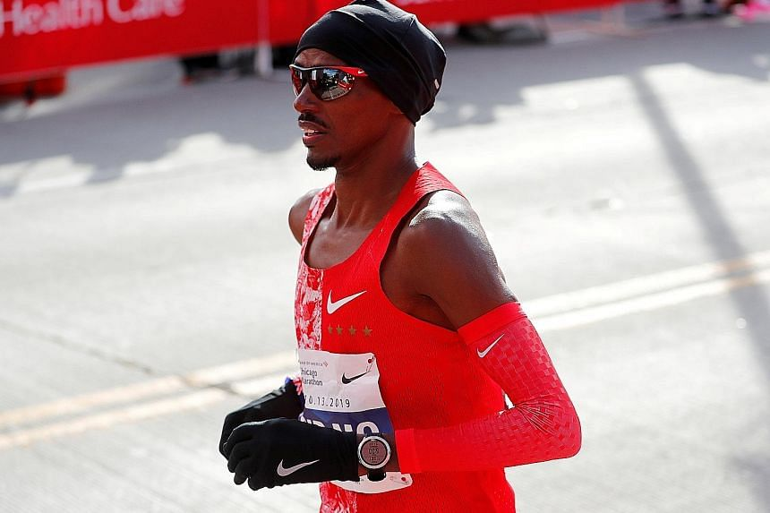 Mo Farah on his way to eighth spot in last October's Chicago Marathon. He insists that he did not lie to investigators about L-carnitine injections but gave a fresh account after remembering the incidents. PHOTO: REUTERS
