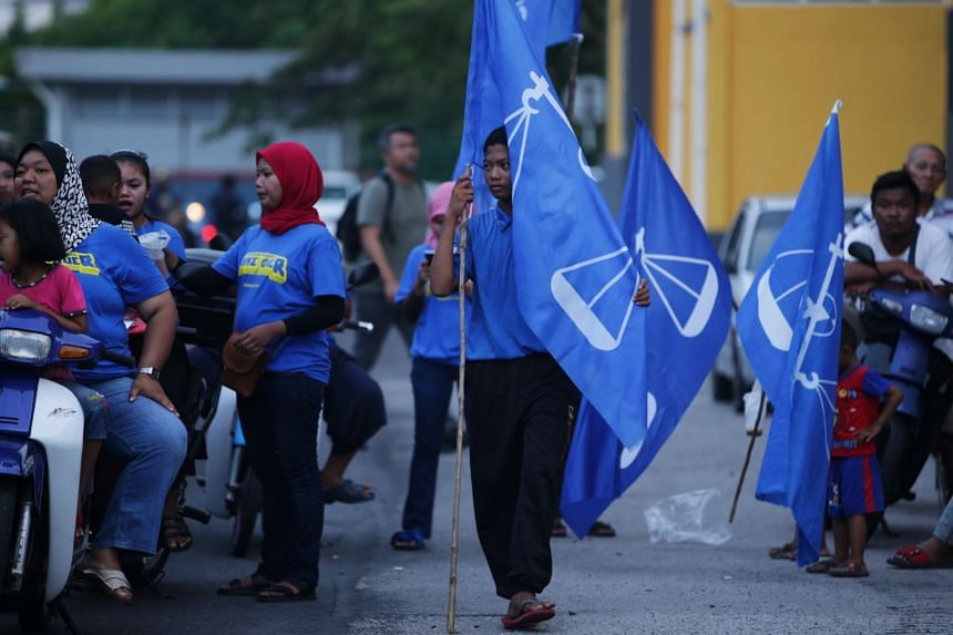 A photo taken on Nov 14, 2019, shows Barisan Nasional supporters in Kukup, in Malaysia's Johor state, ahead the Tanjung Piai by-election.